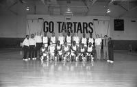 1986-1987 basketball team portrait with coaches and trainers.