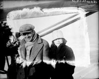 Stinson, Eddie; Flier. In cabin of plane with Randolph Page. Date is Mar. 1928