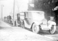Streets; Winter Scenes. Snow Storm. Date is May 1923. Cars Snow Covered. Street scene with policeman