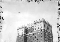 Lindbergh, Colonel Charles; Flying over Detroit News & Hotel Fort Shelby.