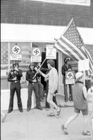 Nazis; Detroit. -Police Confront Angry Citizens at New Bookstore on Fenkell