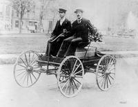King, Charles B. ; Built & Drove 1st Auto In Detroit. Charles B. King in his First Car. . 1 neg