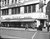 Kinsel Drug Store; Detroit . First Store, 26 Michigan Avenue. in 1890. E. C. Kinsel is standing beside employee in short sleeves. Store at Greydale & Grand River. Store Livernois & Fenkell.