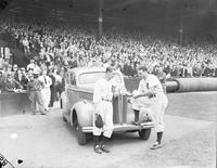 Fox, Ervin (pete); Baseball. Receives a new Buick. With Del Baker inside stadium