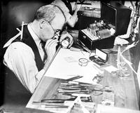 Watchmakers. Employees of Sallan, Inc. repairing precision instruments