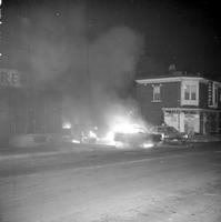 Black Panthers; Negro Militant Organization. -Confrontation with Detroit Police at 3376 16th Street. -Burned Out Police Cars