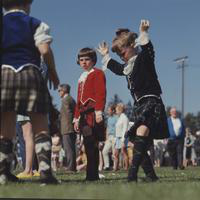 Highland Games; Alma, Michigan. -bagpipe bands. -highland dancers. -tossing of the stone