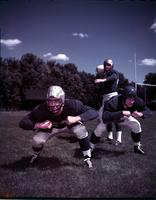 Football; Detroit Lions . Dick Stanfel (wearing face mask), Bobby Layne, & Jim Martin. taken Sept 1953
