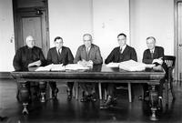 Prohibition; Conference. conference in Detroit  to plan a campaign against blind pigs (*1st Prohibition meeting at Police Headquarters). L to R;    Harry B Kinney - acting Police Inspector, OL Smith - Assistant Attorney General, Andrew B Dougherty - Attorney General, Donald W Sessions - Assistant Attorney General, Eugene A Walling - Assistant Wayne County Prosecutor.