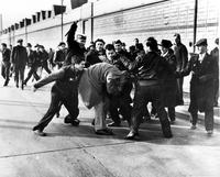 "Ford Motor Co; Employees; Strikes. ""scab"" being beaten by strikers. ** 1942 Pulitzer Prize winning photograph by Milton (Pete) Brooks. ""The Picket Line""."