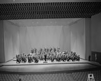 Detroit Symphony Orchestra . Formal Portraits Paul Paray on coonductor's Stand . Conductor unknown For negs