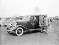 Ford, Henry; Autos. Edsel and Henry with one millionth Ford V8.