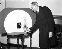 Ford, Henry . Opening of  General Electric Home . passing an oil lamp in front of photo cell.
