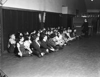 Wars; World; # 2; Detroit; Air Raid; Drills. - Poe school children sitting in hallway for Air Raid practice
