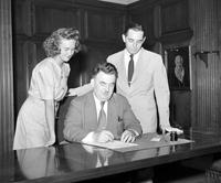 Wars; World; # 2; Prices; Food. - Geo. G. Sadowski signs food petition with Harold Roberts and Lorraine Isaacsen .