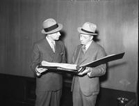 Scripps, William E. Showing Edsel Ford log Book of Early Bird At Ford Rotunda 3 neg