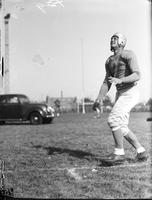 Clark, Earl (Dutch): Pro Football . -Action: Recieving a Pass.