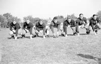 Colleges; University Of Michigan; Football; Team; First line players. Arthur Valpey, William Smith, Ralph Heikkinen, capt. Joe Rinaldi, Fred Olds, Don Stegel, and John Nichillson