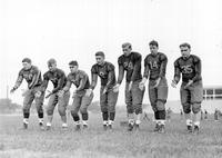 Colleges; University Of Michigan; Football; Team; Quarterbacks. Dick James, Antone Dauksza, George bolas, Lewis Westover, Estil, Tessmer, William W. Renner, Stanley Fay. 1  negs