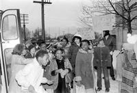 School; Busing; for Desegregation; Detroit; First days of Busing Plan . -Busing to Various  Schools. Principal Henry Wilmers greets kids getting off bus
