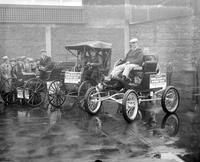 Autos; History; Cars Entered in Contest, Detroit Auto Show: 1932 . -John M. Booth and Mary Sidney in 1898 model Benz. Split first prize with Joseph Hughes