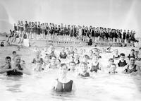Belle Isle; Bathing Beach. Men on raft; Men swimming.
