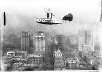 "Detroit; Downtown; With ""Buckeye"" Airplane. Flying over Downtown Detroit. Date is 1923"