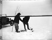 Fishing; Ice; Standish, Michigan; 1950.--Edward Perlberg & wife.--Don Taylor & Roy Williams