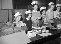 Wars; World; # 2; Red Cross; Detroit; Junior Members. Dolores Garaglie, Margaret Smith, Joan Mulleavy, and Ladonna LaBean filling soldier kits