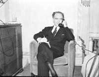 Murphy, Frank; As Governor of Michigan; Individual. Opening his mail. Signing revenue bonds . Telephoning.