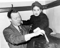 Reuther, Walter P. ; Labor Leader; Family. voting with daughter Linda.