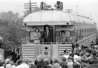 Ford, Gerald R. ; United States President. On whistle stop tour of state, campaigning for Michigan primary (with wife, Betty).