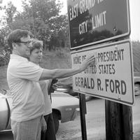 Ford, Gerald R. ; United States President; . City limit sign being changed to declare Ford as President following Nixon's resignation.