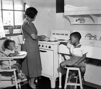 Housing; Blighted Areas; Detroit; Brewster Housing Project. Interior views showing colored family in apt. . .