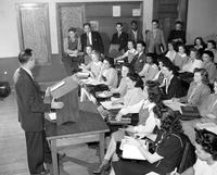 Colleges; Wayne  University; Students. Carl O. Smith conducting Government class