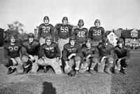 Colleges; Wayne University; Football; Teams. Front row:. Chas. Kouvellas. Joe Stella. Jack Cotton. Bruce Roberts. Jim Hagg. John Clements. Leslie Roberts.--Back Row. Bob Siegfried. Bob Mistele. Bill Hobbs. Nick Cherup