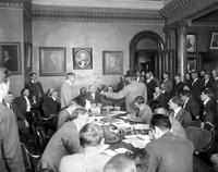 Detroit United Railway; Strike Settlement; June 20, 1911; Aldermen Meeting. Judge James Phelan (standing with hat on) addresses Mayor Wm. B. Thompson on the points of a settlement, Sept. 10, 1911. Copy neg.