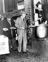 Unemployment; Detroit; Soup Kitchens. -Firemen Feeding the Hungry