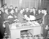 Strikes; Chevrolet Forge Plant; Detroit. -W. J. Scott Receiving Petitions from Workers. -Chevrolet Forging Plant