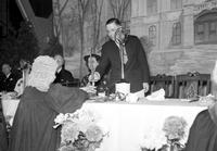 Colleges; University of Michigan; Centennial Celebration. President Ruthven receiving last lighted candle from Prof. J. C. Bier