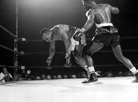 Boxing; Matches; Ezzard Charles vs. Joe Wolcott.