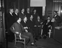 World War 2; Detroit; Tires.--Ration board: Jas. C. Bright, Wm. Gershensen, Henry L. Sinclair, Arron R. McKay, Harry J. Shoemaker & Chester Baringer .--Standing:. T. M. Hall; R. H. Vogel; A. R. McKay; F. H. Couillard; Ed. G. Gelrich; Leo Franklin .--Seated. M. F. Santmyres; C. D. Marks; H. H. Phillips; A. D. Ruegsegger & Wm. F. Connolly.