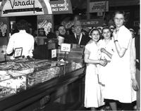 Strikes; F. W. Woolworth; Detroit. Sit-Down Strikers in Woolworth Store. Strikers Read Newspapers at Lunch Counter.