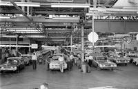 Chrysler Corporation; Plants; Plymouth. Employees leaving plant. Assembly line.