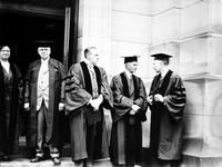 Ford, Henry. giving degree at U of M. Date is 1926. President Little. Sir F. Whyte.