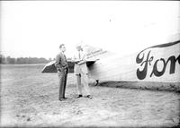 "Ford, Henry; With Edsel Ford at Ford Airport. -Standing Beside ""Maiden Dearborn II"" Plane"