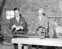 Ford Motor Company; Anniversaries; 40th. -Edsel & Henry Ford Working in Laboratory on First Ford Gasoline Engine