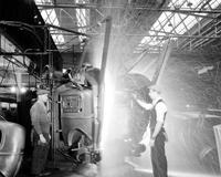 Ford Motor Co. ; plants; River Rouge. welding machine . welding back & two sides of car.