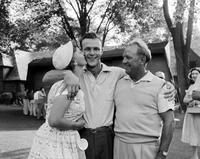 Palmer, Arnold; Golfer. with his parents.