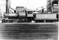 Railroads; locomotives. History. Detroit, Toledo, & Ironton. Henry Ford in cab. Copy. Date is 1921